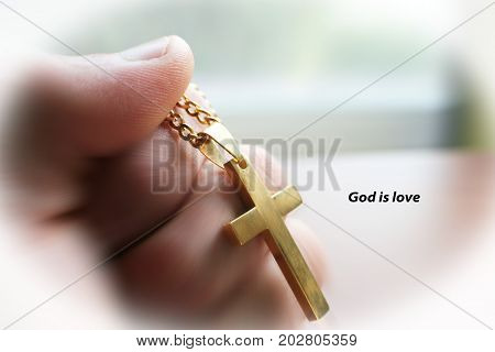 Religious Golden Cross In Hand With God Is Love High Quality