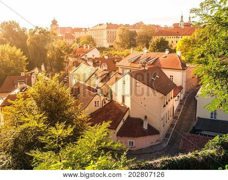 Aerial view of old medieval narrow cobbled street and small ancient houses of Novy Svet, Hradcany district, Prague, Czech Republic.