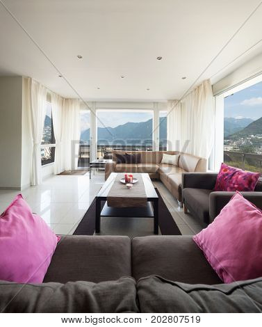 Living room with a splendid view on Lugano lake