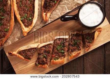 Pide, turkish meat and pastry street food similar to pizza