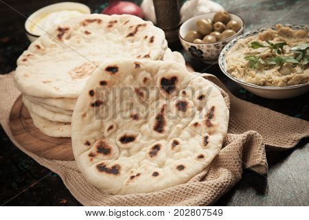 Home made pita bread, flatbread used in turkish, lebanese, levantine and other oriental cuisines