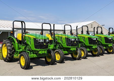 Indianapolis - Circa August 2017: 5045E Tractors at a John Deere Dealership. Deere manufactures agricultural construction and forestry machinery VI