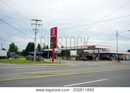 CADILLAC, MICHIGAN / UNITED STATES - JUNE 22, 2017: One may purchase gasoline at the Speedway Gas Station on Mitchell Street.