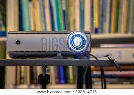 Portable beamer projector working on an office during presentation of bussines results