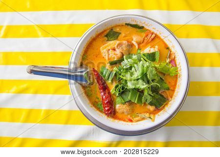 spicy soup with shrimp Tom Yum Soup Tom Yum GoongThai Food Top view on colorful background