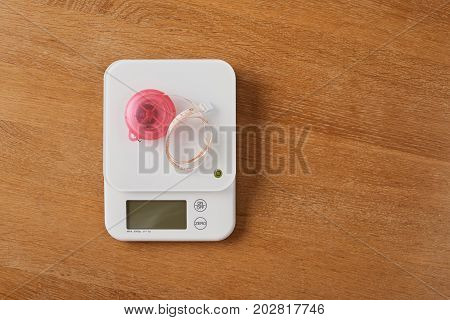 White Food Scales With Pink Tapeline