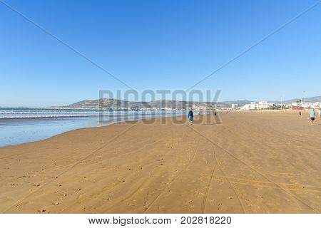 Agadir. Morocco - December 23 2016: Long wide beach in Agadir city Morocco. The hill bears the inscription in Arabic: