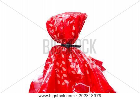 The Black Cable Tie Tighten With Orange Plastic Bag On White Background Isolate