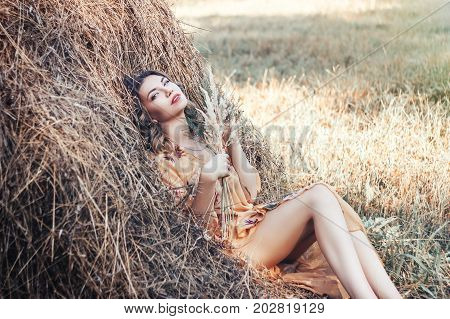 Woman lying in dry grass and relaxing