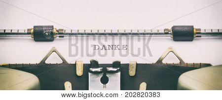 Close-up of of word DANKE on a typewriter sheet