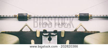 Close-up of DEAR SANTA on a typewriter sheet