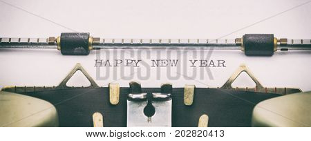 Close-up of HAPPY NEW YEAR on a typewriter sheet