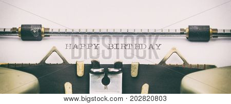 Close-up of HAPPY BIRTHDAY on a typewriter sheet