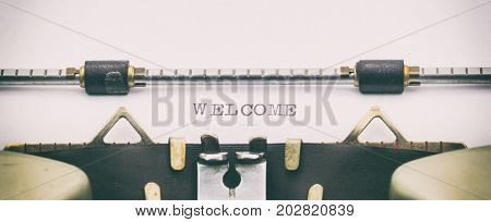 Close-up of word WELCOME on a typewriter sheet