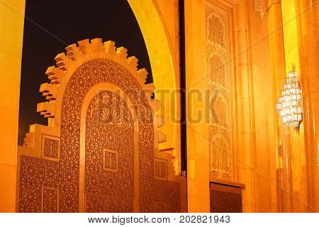 The Big Gate Titanium door of King Hussan II Mosque archwaysNight time in Casablanca MoroccoAfrica