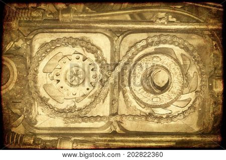 Grunge background with texture of old soiled paper and details of vintage gear with gears and chain