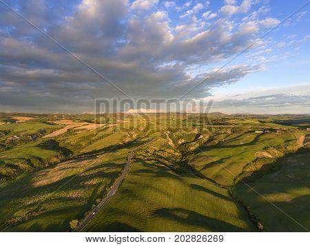 Tuscany aerial sunrise farmland hill country landscape. Italy, Europe.