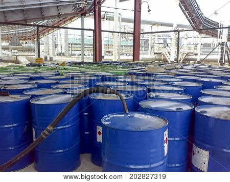 Barrels With A Reagent In A Warehouse Under A Canopy. Petrochemistry For The Production Of Commercia