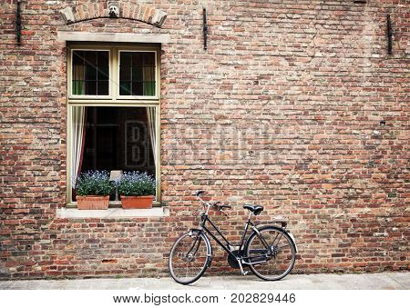 Bicycle parked outside shuttered windows