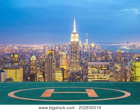 New York City skyline with urban skyscrapers at dusk with Hilipad , USA.