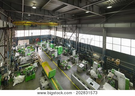Assembly shop. Manufacture of metalworking machines. Modern machine-building enterprise. View from the top point.