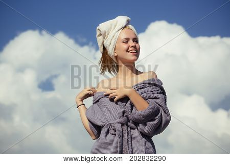 Girl Smiling On Cloudy Blue Sky