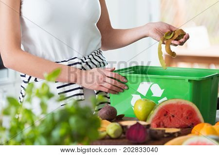 Woman Composting Organic Kitchen Waste
