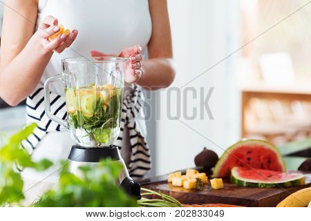 Woman Preparing Energetic Smoothie