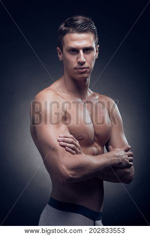 One Young Adult Man, Caucasian, Fitness Model, Muscular Body, Shirtless, Upper Body Shot, Black Back