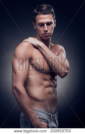 One Young Adult Man, Caucasian, Fitness Model, Muscular Body, Shirtless, Jeans, Black Background, St