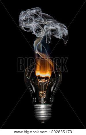 Broken light bulb with flame and smoke