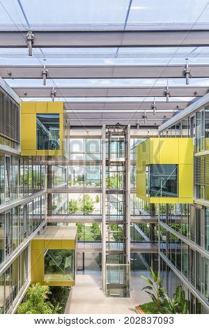 Main hall, staircase and windows of morden office building. Contemporary corporate business architecture. Munich Trading and Technology Centre.
