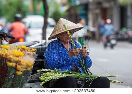 HO CHI MINH CITY (SAIGON), VIETNAM - JULY 2017 : Flower vendor in Saigon, Ho Chi Minh City, Vietnam