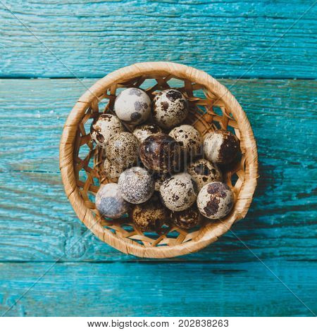 Image of quail eggs in straw basket