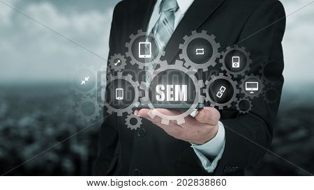 Search engine marketing - SEM concept. Businessman or programmer is focused to improve SEM and web traffic