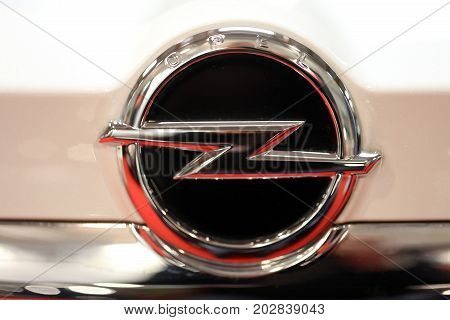 CRACOW POLAND - MAY 20 2017: Opel metallic logo closeup on Opel car displayed at MOTO SHOW in Cracow Poland. Exhibitors present most interesting aspects of the automotive industry