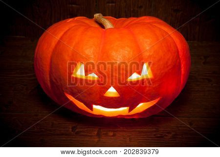 Scary Halloween Pumpkin On A Old Wooden Background