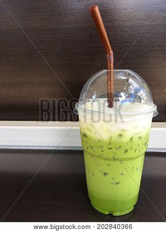 Ice Green tea on a wood table