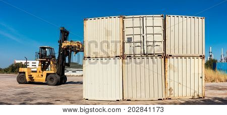 Cargo and shipping yard Business Logistics Handling and storage containers by forklift.