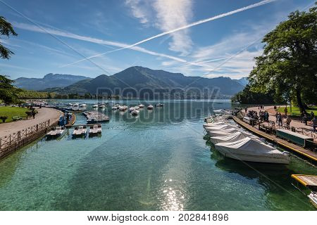 Annecy France - May 25 2016: View of river mouth lake and boat from Pont des Amours (Bridge of Love) in Annecy France. Annecy is a commune in the Haute Savoie department of the Rhone-Alpes region in south-eastern France.