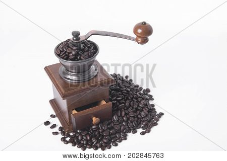 coffee grinder with arabica coffee beans on white background.