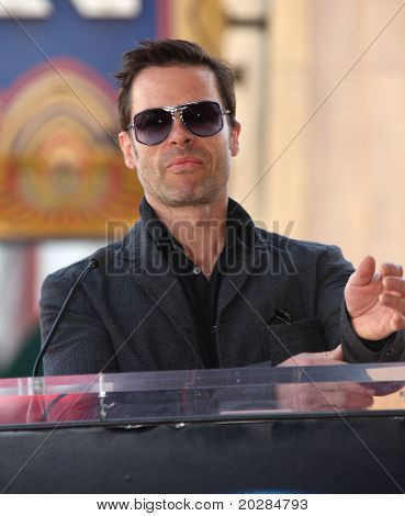 HOLLYWOOD - JAN 13:  Guy Pearce actor Colin Firth receives star on walk of fame  on January 13, 2011 in Hollywood, CA