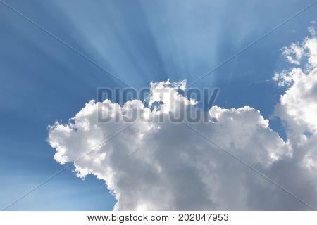 Clouds Blue Sky and Sun Streaks