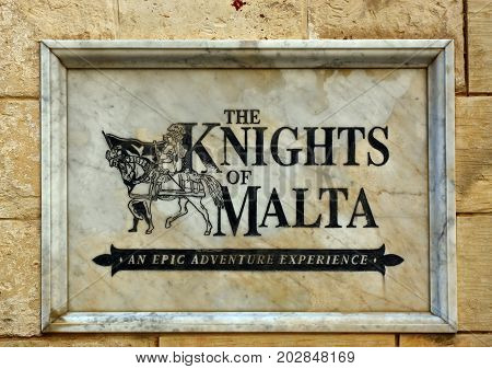 MDINA, MALTA - MARCH 29, 2017 - The Knights of Malta sign set in a wall Mdina Malta Europe, March 29, 2017.