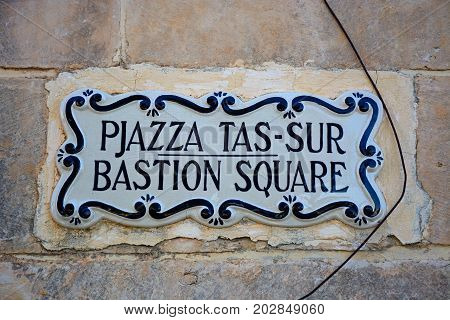 MDINA, MALTA - MARCH 29, 2017 - Bastion Square sign set in a wall Mdina Malta Europe, March 29, 2017.