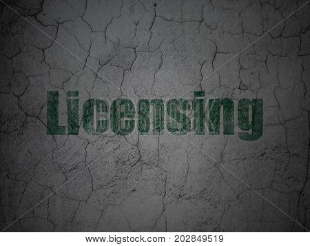 Law concept: Green Licensing on grunge textured concrete wall background