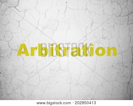 Law concept: Yellow Arbitration on textured concrete wall background