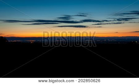 Heroic summer evening with beautiful sunset and twilight colors above the Rhône vally. In the distance view of the Ardeche and the city of Valence