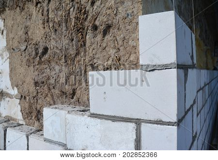 Bricklaying Brickwork. Bricklaying on House Construction Site from White Bricks