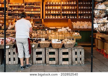 Munich, Germany - August 3, 2017: Woman shopping food in Viktualienmarkt. It is a daily food market and a square in the center of Munich near Marienplatz